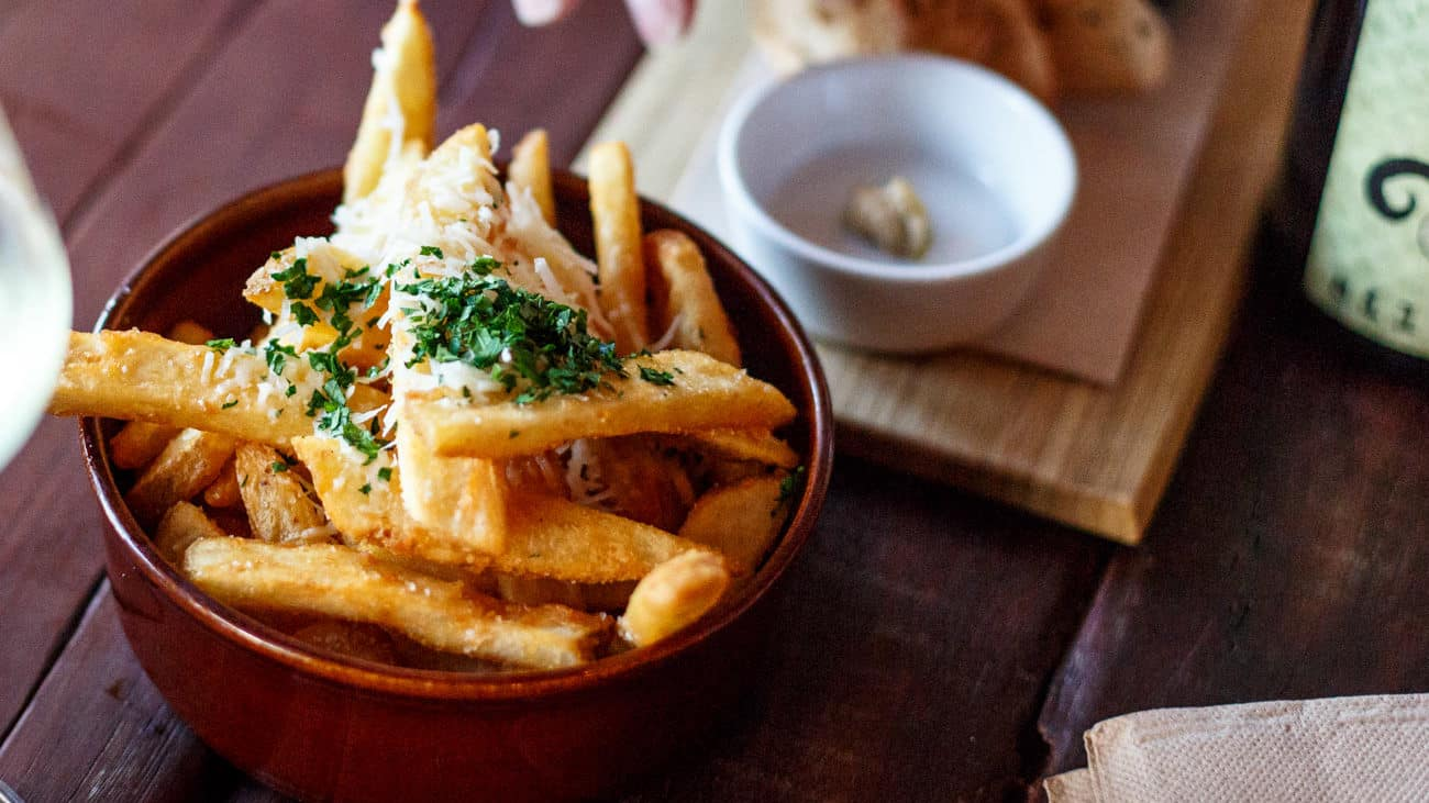 Beer battered chips with parmesan and truffle oil