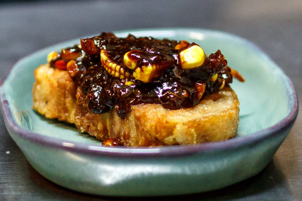Pork belly, corn, peppers and our sticky honey tamarind